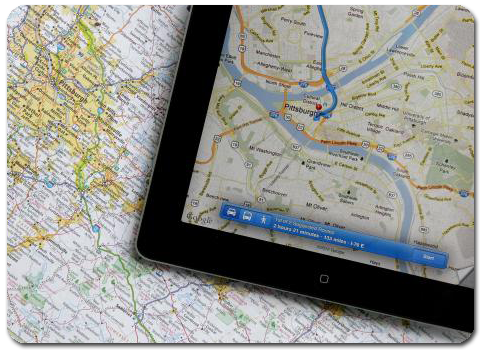 Tablet with GPS sitting on Map